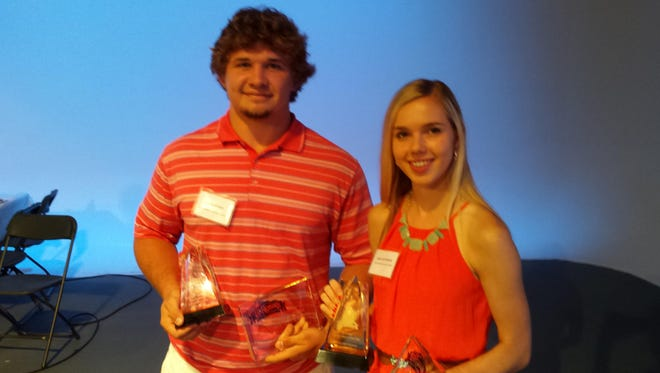 Austin Myers of Campbell County and Annie Heffernan of St. Ursula show off their hardware after the LaRosa's Hall of Fame Banquet.