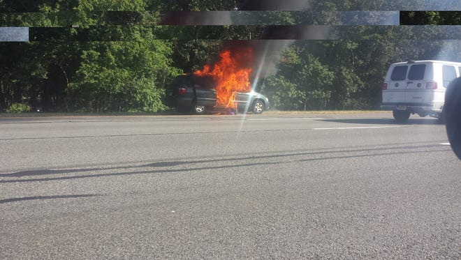 The driver of this Chrysler Town & Country van suffered only minor burns when it burst into flames in the southbound lanes of the Garden State Parkway, near Exit 102 in Tinton Falls.