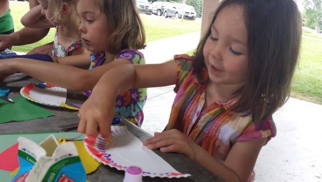 Sophia and Jacqueline Garcia work on crafts at a Get Fit Great Falls event at Lions Park.
