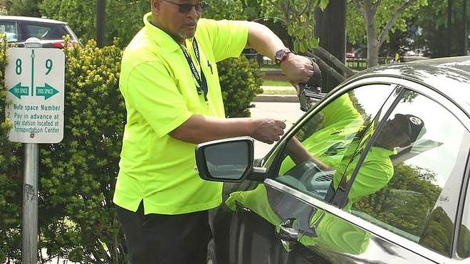 Parking attendants such as Simon Bailor, above, will be resuming regular enforcement in the coming days.