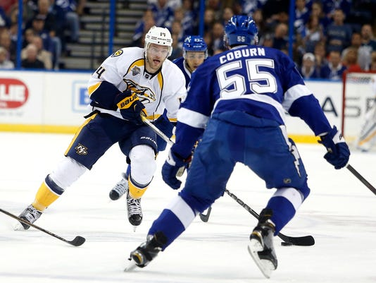 Nashville Predators defenseman Mattias Ekholm (14), of Sweden, controls the puck against Tampa Bay Lightning defenseman Braydon Coburn (55) during the first period of an NHL hockey game Friday, Feb. 12, 2016, in Tampa, Fla. (AP Photo/Brian Blanco)