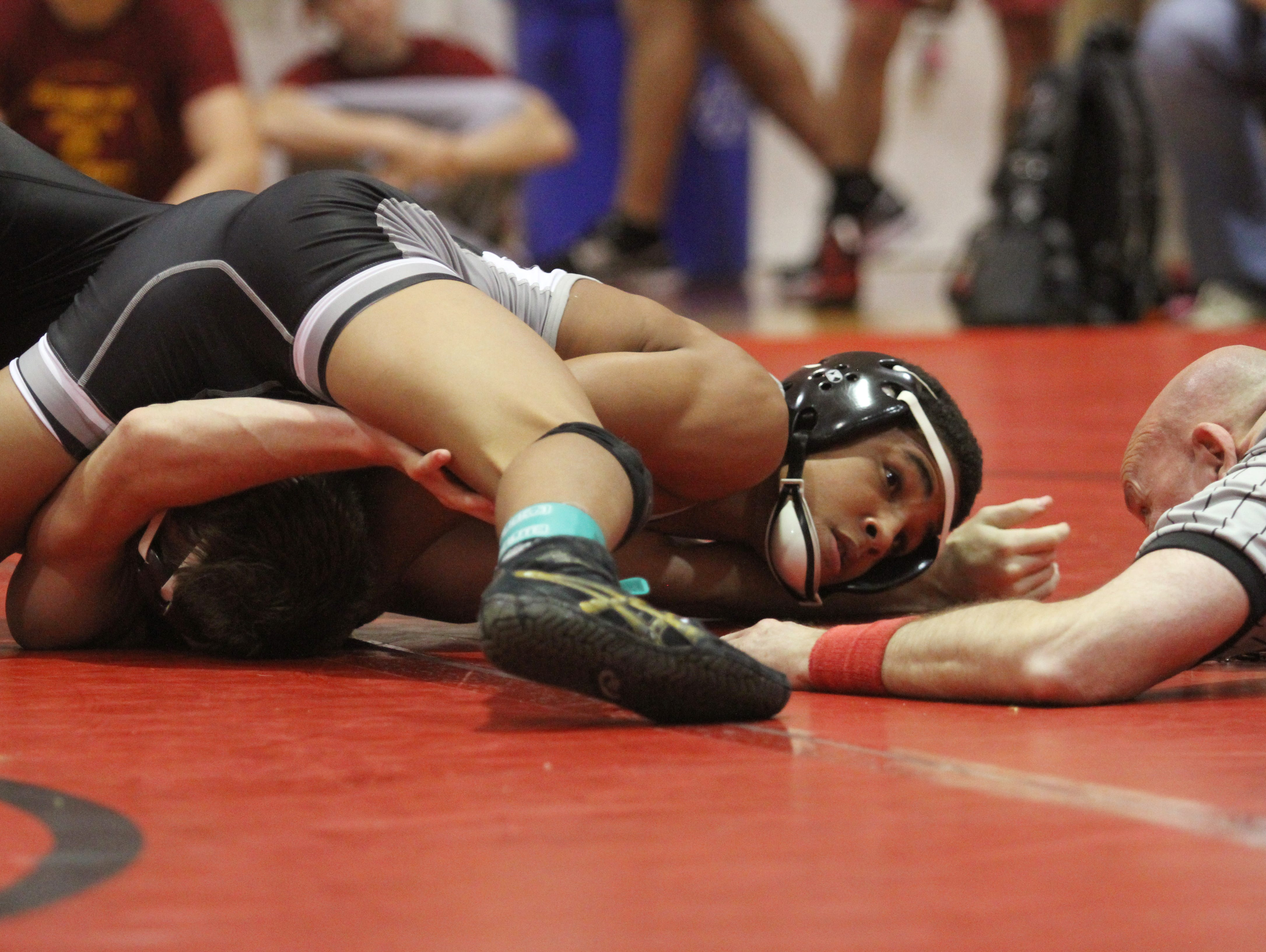 Mariner's Christian Minto pins Riverdale's Trey Floyd to win the 126-pound weight class in the District 2A-11 Wrestling Championships on Friday at North Fort Myers High School.