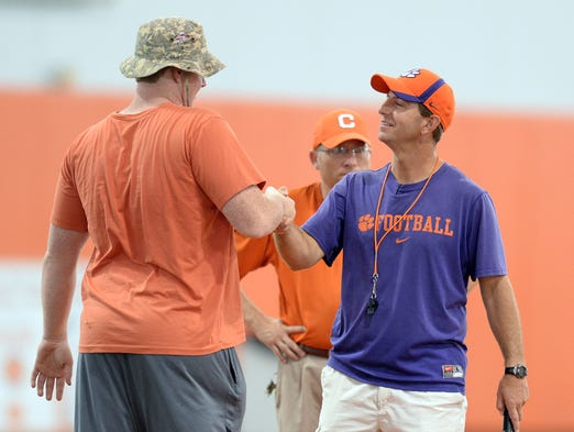 Zach Giella and Clemson head coach Dabo Swinney at the Dabo Swinney Football Camp Sunday, June 15, 2014.