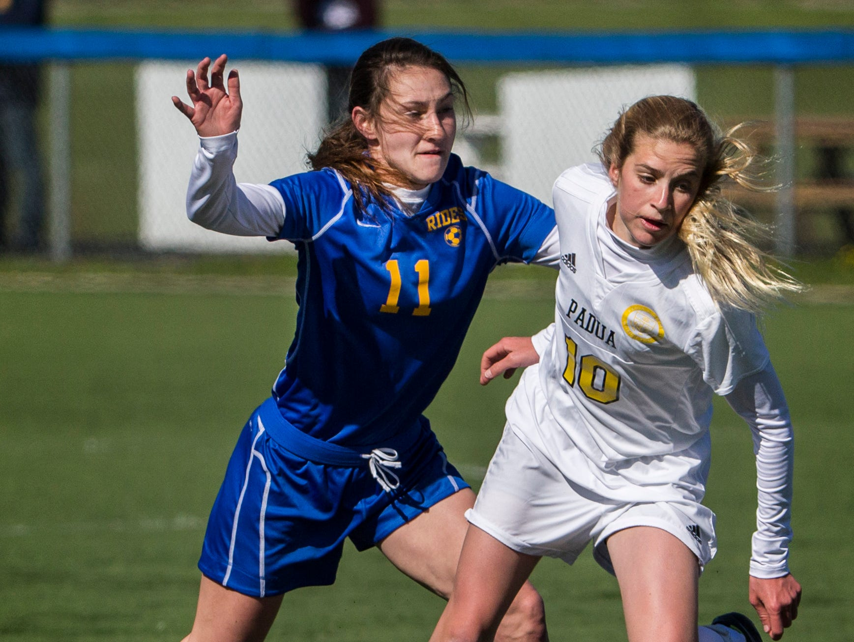 Padua's Ashlee Brentlinger (right) works the ball past Caesar Rodney's Cowan Cummings (left) in the first half of Padua's 2-0 win over Caesar Rodney at the Hockessin Soccer Club on Tuesday afternoon.