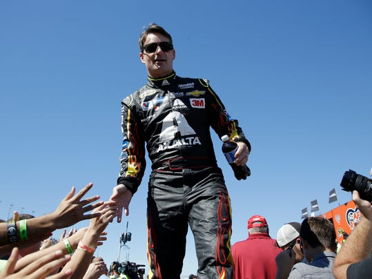 Jeff Gordon greets with fans during drivers introduction before the NASCAR Sprint Cup Series auto race at Chicagoland Speedway, Sunday, Sept. 20, 2015, in Joliet, Ill. (AP Photo/Nam Y. Huh)