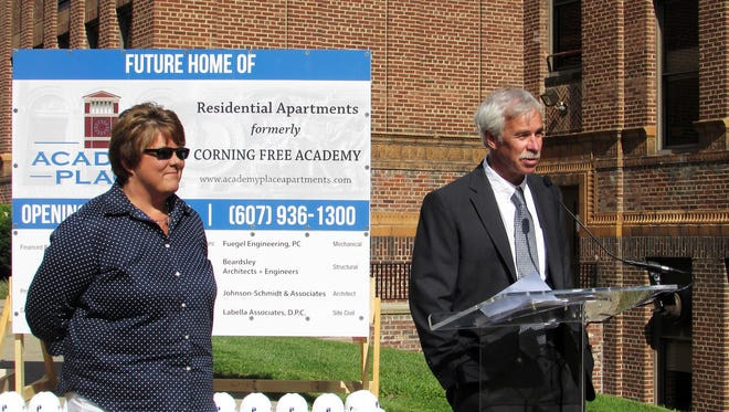 Developer Mark Purcell, owner of Purcell Construction Co. of Watertown, talks about plans to convert the former Corning Free Academy into apartments during a groundbreaking ceremony Thursday. Looking on is company Chief Financial Officer Christine Schnieder.