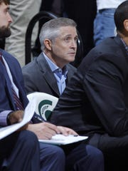 Brian Gregory sits behind the Michigan State bench