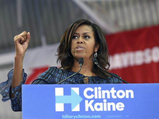 First lady Michelle Obama speaks at LaSalle University in Philadelphia on Sept. 28, 2016, as she campaigns for presidential candidate Hillary Clinton. Obama will will address an Arizona Democratic Party get-out-the-vote rally on Thursday in Phoenix.