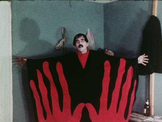 The Master (Tom Neyman) displays the very cool robe