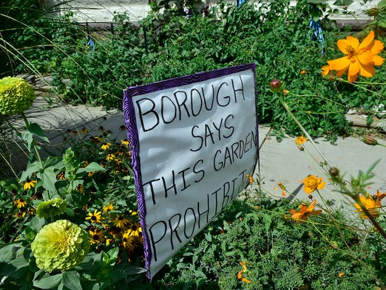 Harriett Diller has a sign in her yard in protest of