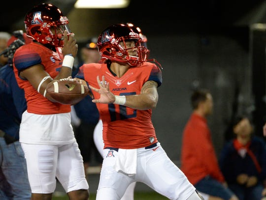 Arizona Wildcats quarterback Anu Solomon (12) warms up before the game against the Colorado Buffaloes at Arizona Stadium on Saturday.