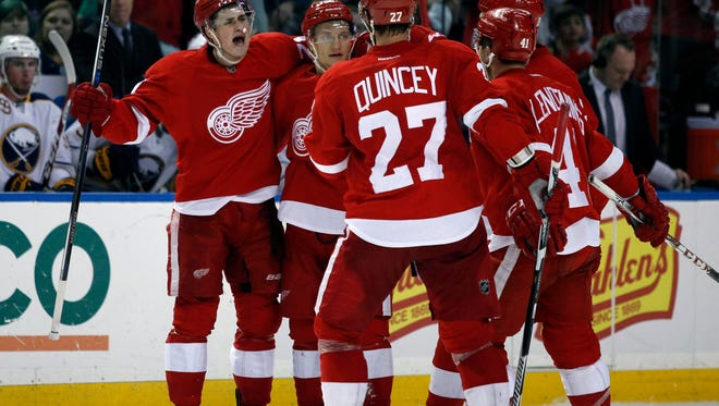 Jan 22, 2016; Buffalo, NY, USA; Detroit Red Wings center Dylan Larkin (71) celebrates his third period goal with teammates against the Buffalo Sabres at First Niagara Center. Detroit beats Buffalo 3 to 0. Mandatory Credit: Timothy T. Ludwig-USA TODAY Sports