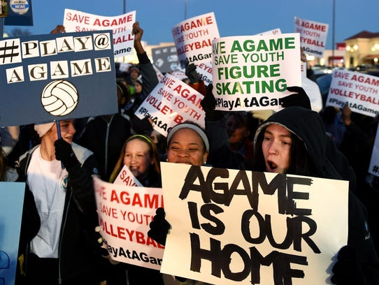 Volleyball player Hollie Haynie, 16, right, protests