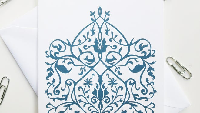 Blank sets of note cards with Islamic-inspired paper cut designs are by Yvonne Laube.