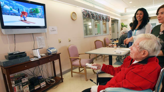 Walter Zimney, 87, a former 1980 Olympic official, competes in the Ski Jump on Nintendo Wii at Franciscan Oaks in Denville participate in the Wii Olympics in this 2010 file photo.
