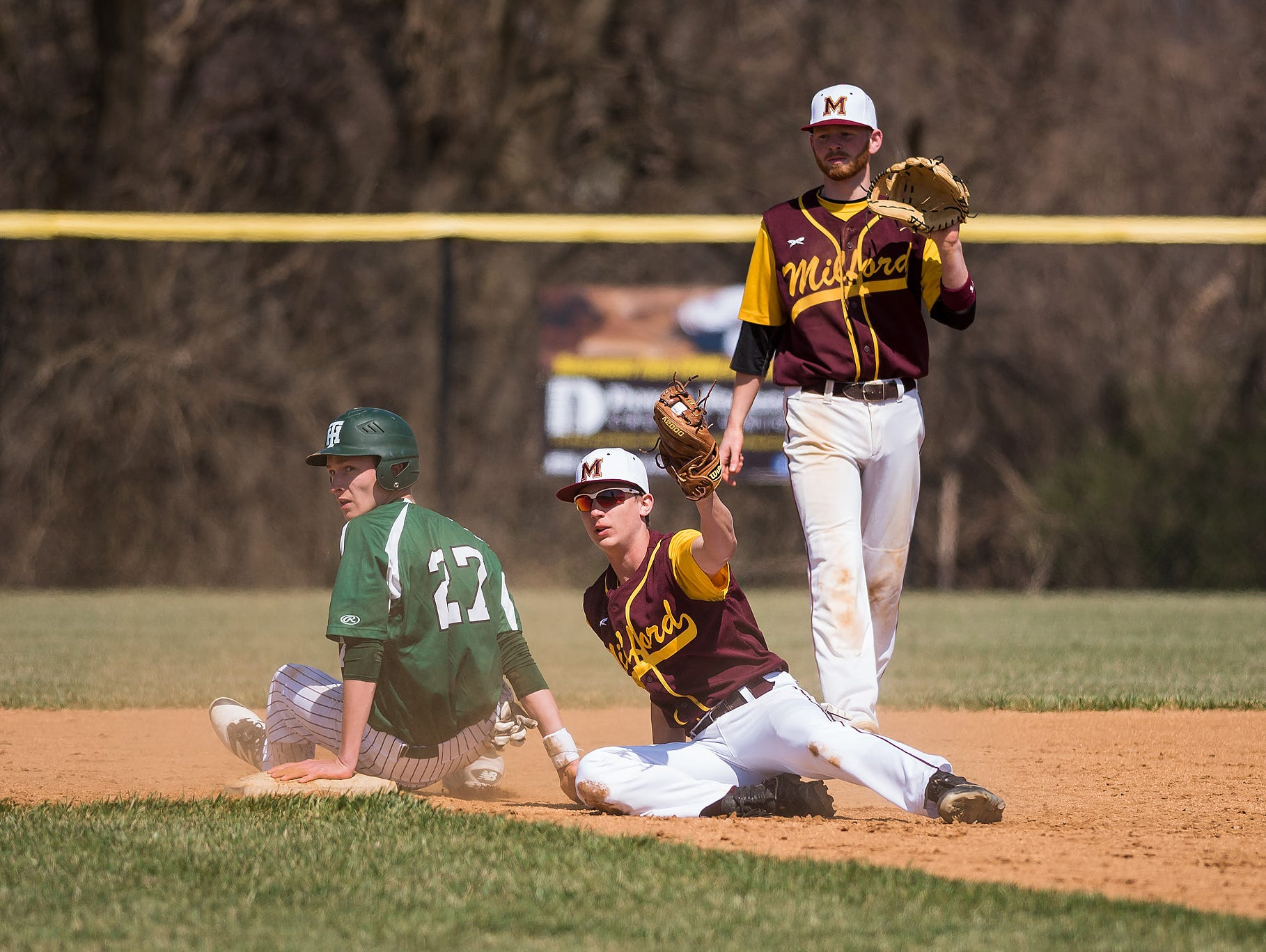 William Kimmel of Milford tags out Bo Anderson at second base in a Tower Hill vs Milford baseball game at Milford High School on Saturday.