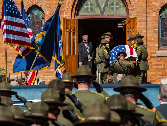 Vermont State Trooper Kyle Young's casket arrives for