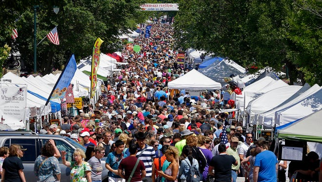 Downtown Cedarburg is packed with patrons during a previous strawberry festival. This year's festival has been called off because of concerns over the coronavirus.