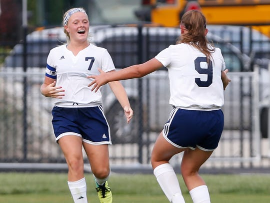 Central Catholic's Lindsey Kiracofe, left, celebrates with Annie O'bryan after her goal late tied the score 2-2 with Lafayette Jeff Wednesday, August 16, 2017, in Lafayette. CC and Jeff played to a 2-2 draw.