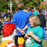 Ronald McDonald greeted children at the 2014 Buddy Walk at World's Fair Park in Knoxville. Event organizers estimated more than 1,200 people gathered to raise awareness and funding for people with Down syndrome.