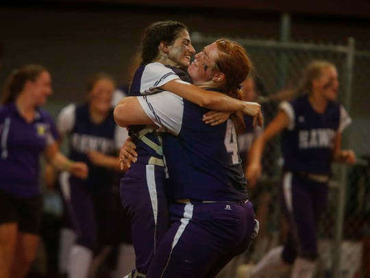Members of the Kee High softball team celebrate a 7-3