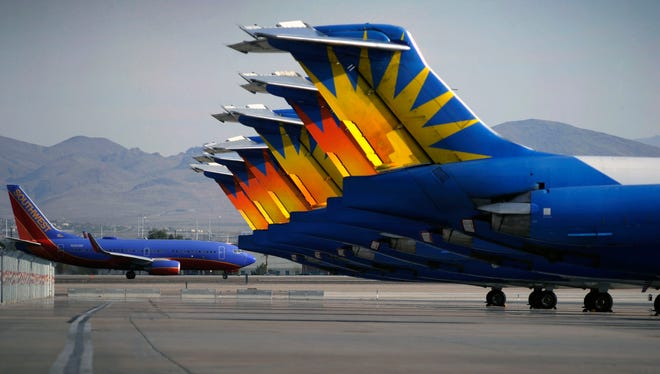 In this Thursday, May 9, 2013, photo, Allegiant Air jets at McCarran International Airport in Las Vegas.