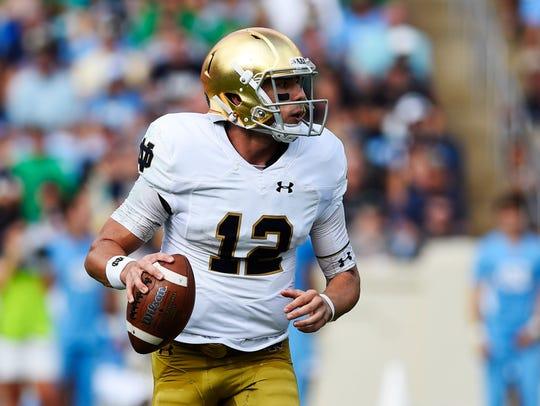 Notre Dame Fighting Irish quarterback Ian Book (12)