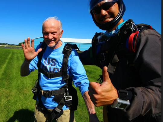 Chuck Chapeta, 91, is all smiles after his jump with tandem instructor Kazu Oyama.