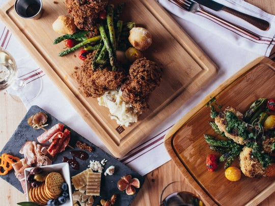 You can get small plates, crispy fried chicken and charcuterie boards at Queen City Wine Dive.