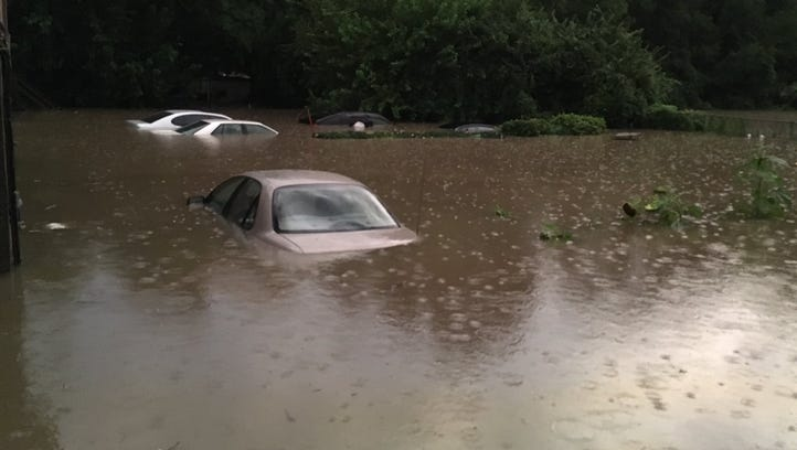 Cars covered in flood waters near the corner of Vine