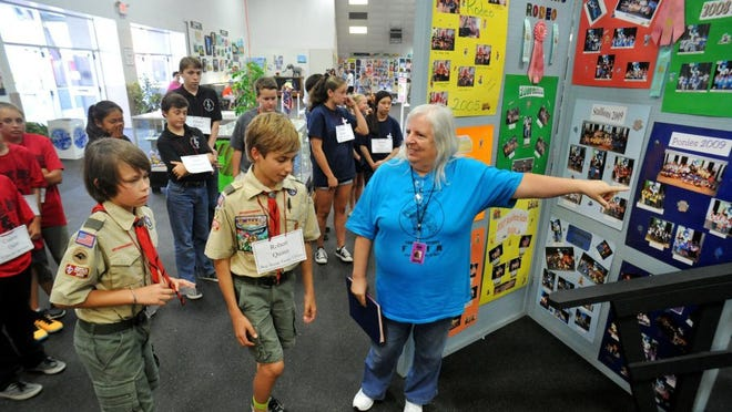 JOSEPH A. GARCIA/THE STAR Chris Roper (right), who has helped with the Academic Rodeo for the past 15 years, gets a group of Boy Scouts to take their seats before the start of a spelling bee competition that was part of the Academic Rodeo at the Ventura County Fair on Saturday. Roper, who now lives in New Mexico, said she comes to help at the event.