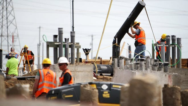 Construction workers continue progress on the 75-acre, $975 million TVA natural gas-fired electrical generating plant that will replace the Allen Fossil Fuel plant at the Frank C. Pidgeon Industrial Park. Roughly 280 workers are working shift around the clock to the keep the project on schedule.