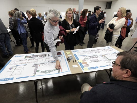 Kern Place residents vote on their favorite signage for the neighborhood during a public input meeting Monday at UTEP.