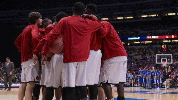 Louisville huddles be there game against UK during Sweet 16 at the Lucas Oil Stadium in Indianapolis. Mar. 28, 2014