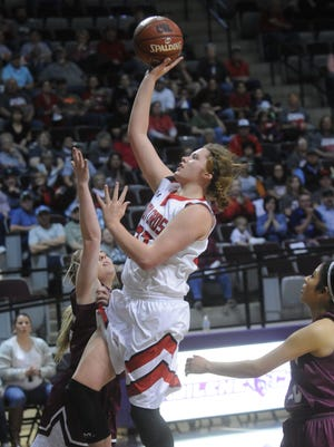 Hermleigh's Makia Gonzales drives to the basket against the Klondike defense in the second half. Hermleigh won the Region II-1A final 41-30 on Saturday, Feb. 24, 2018 at ACU's Moody Coliseum.