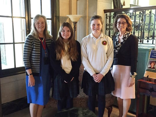 Theology teachers Madeline Soccodato and Susan Choma are pictured with their students Brianna Hunt, center (left) and Grace Schleck, center (right).