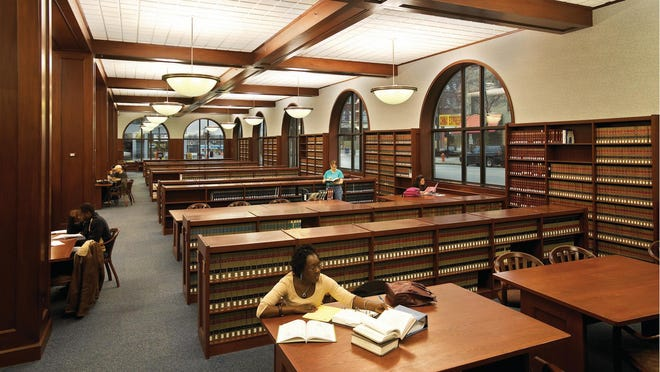 Western Michigan University Cooley Law School students studying inside the library's Strosacker Room during exam week