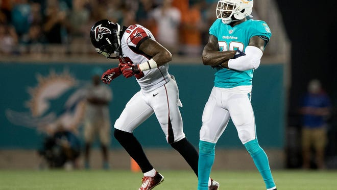 Miami Dolphins strong safety Reshad Jones celebrates an interception he made in the end zone at Camping World Stadium in Orlando, Florida on August 25, 2016.