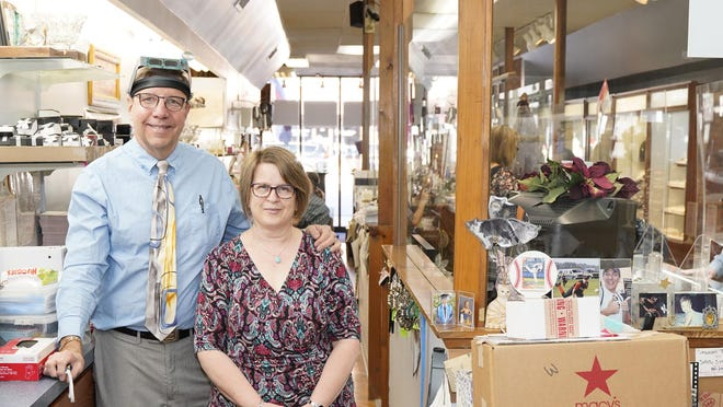 Dan and Barb Hacker are pictured Friday in their store, Hacker Jewelers. The Hackers are retiring and closing the business.