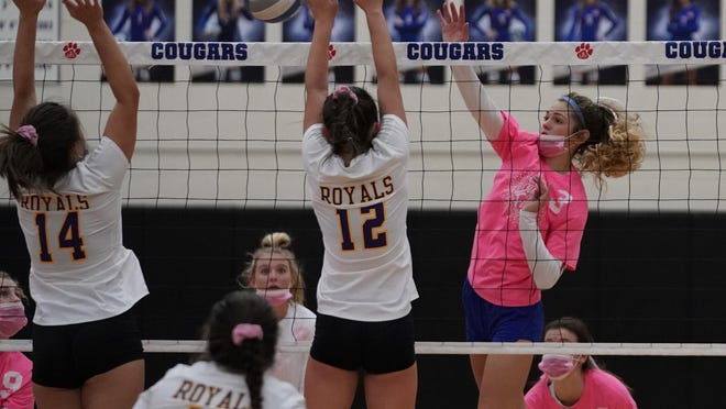 Lenawee Christian's Isabelle Kirkendall (3) drives a kill attempt against a block from Blissfield's Kylee Noel (14) and Kendall Sullivan (12) during their nonconference matchup Monday night at Lenawee Christian School.