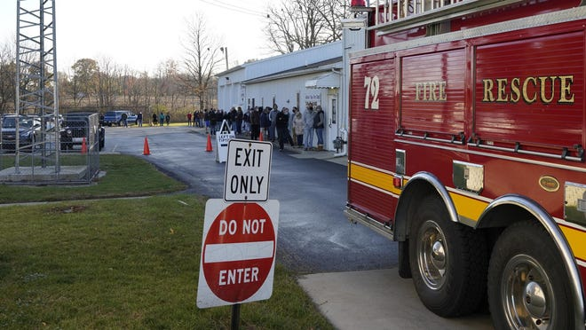 Voters wait outside Tuesday morning at the Adrian Township Fire Department. At times, it took about one hour to vote.
