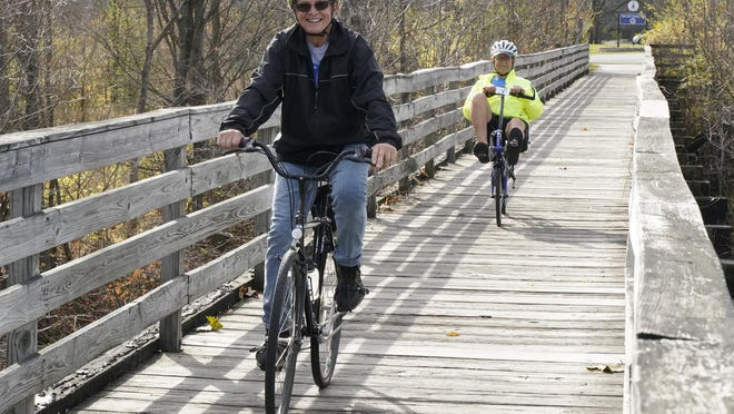 John Valenti of Tipton, followed by Denny Francisco of Plymouth, were both out-and-about Tuesday afternoon, enjoying the Kiwanis Trail at Bent Oaks Crossing in Adrian, while also enjoying the warm weather trends here in Lenawee County.