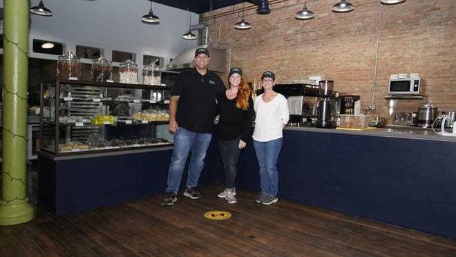 From left, Ben and Deveny Rosebrock and Joyce Miller, owners of The Buzz Cafe and Marketplace, 110 E. Maumee St., Adrian. The cafe offers soups, sandwiches and a grab-and-go market. Masks were removed for picture purposes only.