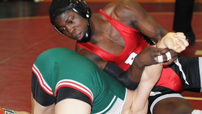 Bound Brook's Stephan Glasgow (red) seen wrestling Ridge's Will Schmidt in last Saturday's District 18 final at 145 pounds is the No. 2 seed behind Edison's Will Povalac at Region V.