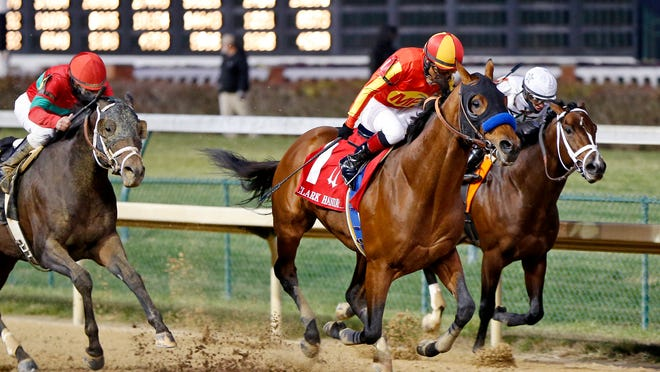 Hoppertunity (1) charges down the stretch to win the Grade I Clark handicap at Churchill Downs on Friday.
