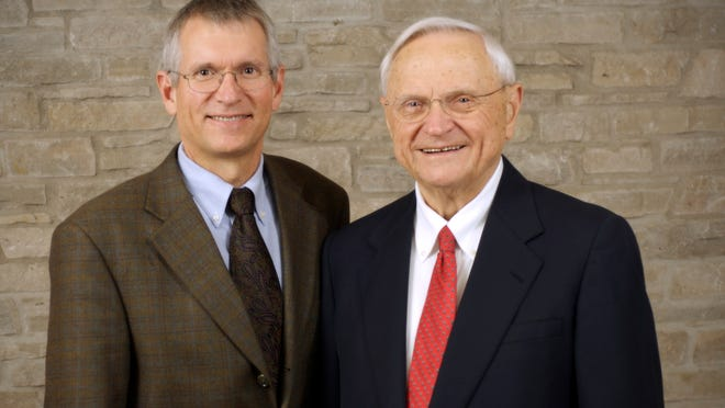 Tom Boldt, CEO of The Boldt Company, stands with his father Oscar C. Boldt, Chairman of The Boldt Company.