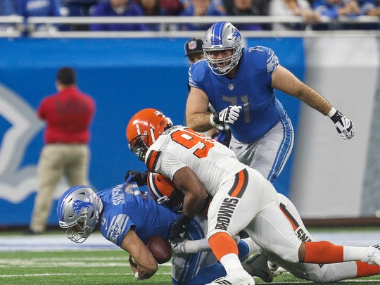 Lions tackle Rick Wagner watches the Browns sack quarterback Matthew Stafford in the first half at Ford Field, Sunday, Nov. 12, 2017.