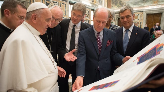 Pope Francis receives the final volume of The St. John's Bible on Friday at the Vatican. With Pope Francis are Abbot John Klassen, St. John's Abbey, from left; Michael Hemesath, president of St. John's University; Donald Jackson, artistic director of The St. John's Bible; and Katharine and Dan Whalen.
