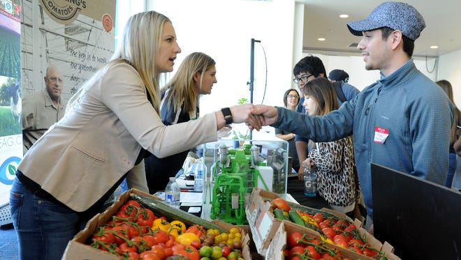 Monica Houweling, left, a product manager for Houweling's Tomatoes of Camarillo, speaks with Ruben Bustamante of Ventura College at the Ventura County Agricultural Summit 2017 held Friday at the Ventura County Office of Education Conference and Educational Services Center in Camarillo. Students learned about STEM-related careers in agriculture during the summit as they talked to people who work in the agricultural industry.