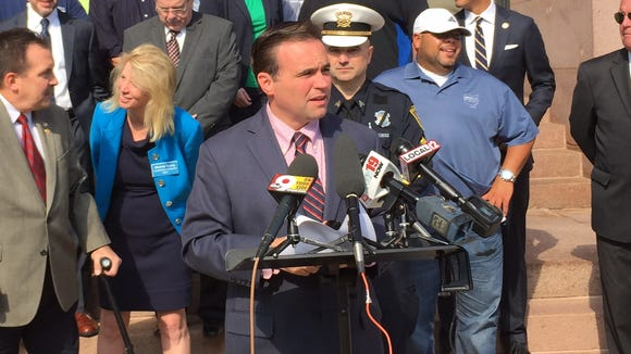 Mayor John Cranley, joined by politicians and union